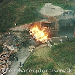 A blaze of wooden pallets during a DISTEX exercise in the 1990's at the East Weare Batteries site